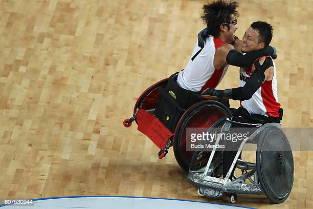 Daisuke Ikezaki of Japan celebrates with a teammate after winning the match against Canada in the Men's Wheelchair Rugby Bronze Medal match on day 11...