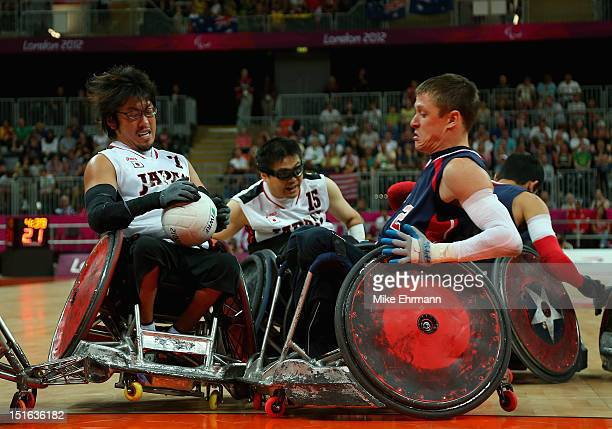 Daisuke Ikezaki of Japan collides with Seth McBride of the United States during the Bronze Medal match of Mixed Wheelchair Rugby against on day 11 of...