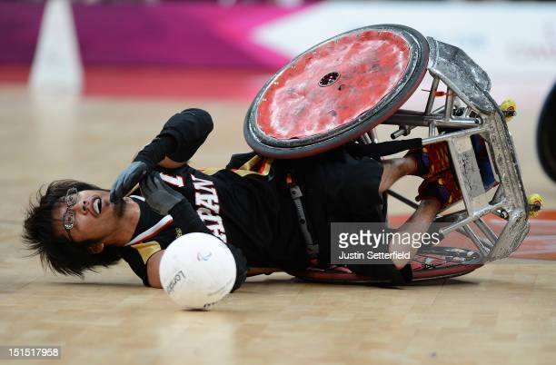 Daisuke Ikezaki of Japan falls to the floor during the Mixed Wheelchair Rugby Open semifinal match between the Australia and Japan on Day 10 of the...