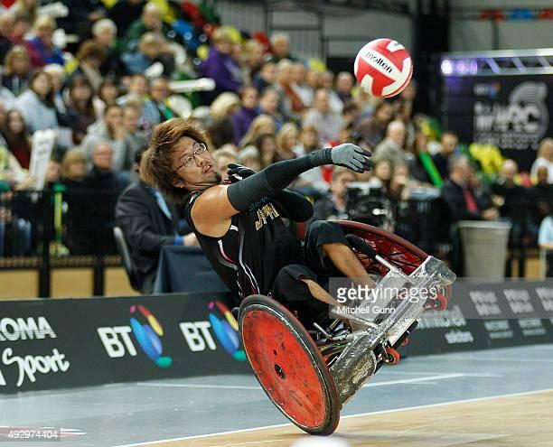Daisuke Ikezaki of Japan throws a pass before crashing out during the 2015 BT World Wheelchair Rugby Challenge bronzen medal playoff match between...