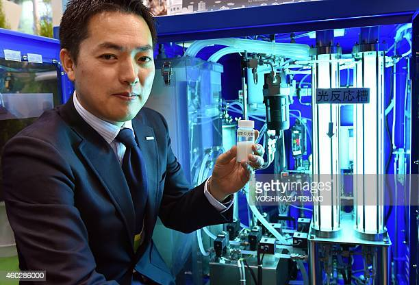 Daisuke Ino a smart water department researcher for Japanese electronics giant Panasonic displays the company's new water purification system using...