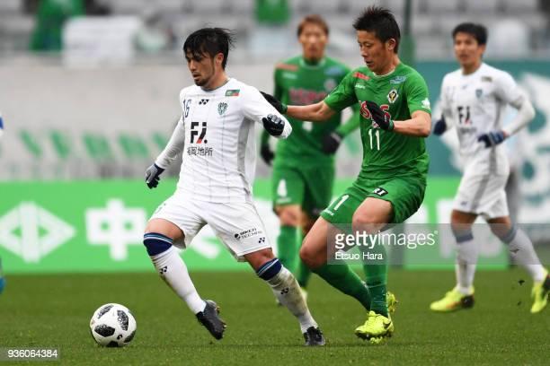 Daisuke Ishizu of Avispa Fukuoka and Ryohei Hayashi of Tokyo Verdy compete for the ball during the JLeague J2 match between Tokyo Verdy and Avispa...