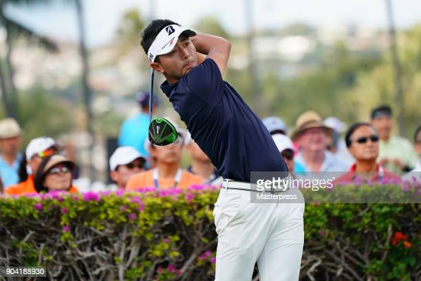 Daisuke Kataoka of Japan hits a tee shot on the 10th hole during the first round of the Sony Open in Hawaii at Waialae Country Club on January 11...