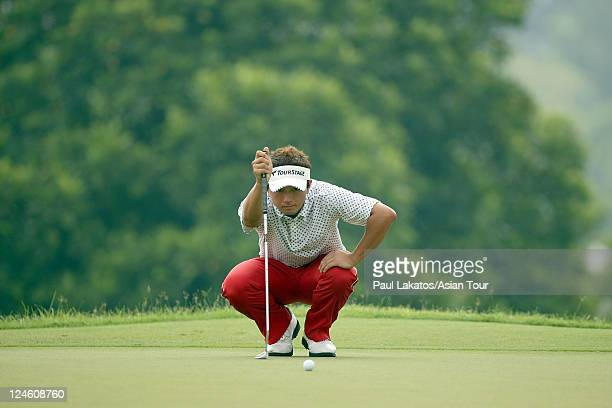 Daisuke Kataoka of Japan lines up a putt during round four of the ISPS Handa Singapore Classic at Orchid Country Club on September 11 2011 in...