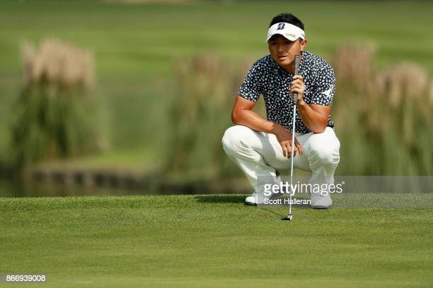 Daisuke Kataoka of Japan lines up a putt on the 14th green during the second round of the WGC HSBC Champions at Sheshan International Golf Club on...