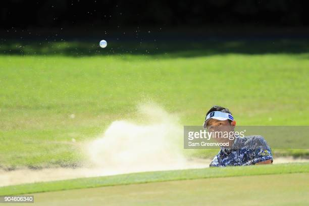 Daisuke Kataoka of Japan plays a shot from a bunker on the first hole during round three of the Sony Open In Hawaii at Waialae Country Club on...