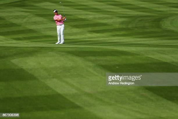 Daisuke Kataoka of Japan plays a shot on the second hole during the third round of the WGC HSBC Champions at Sheshan International Golf Club on...