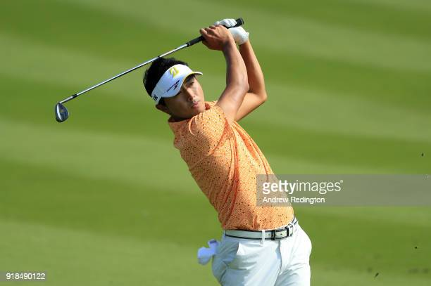 Daisuke Kataoka of Japan plays his second shot on the par four 2nd hole during the first round of the NBO Oman Open at Al Mouj Golf on February 15...
