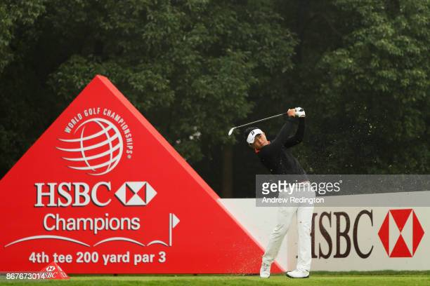 Daisuke Kataoka of Japan plays his shot from the fourth tee during the final round of the WGC HSBC Champions at Sheshan International Golf Club on...