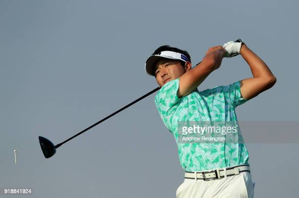 Daisuke Kataoka of Japan watches his tee shot on the par five 7th hole during the second round of the NBO Oman Open at Al Mouj Golf on February 16...