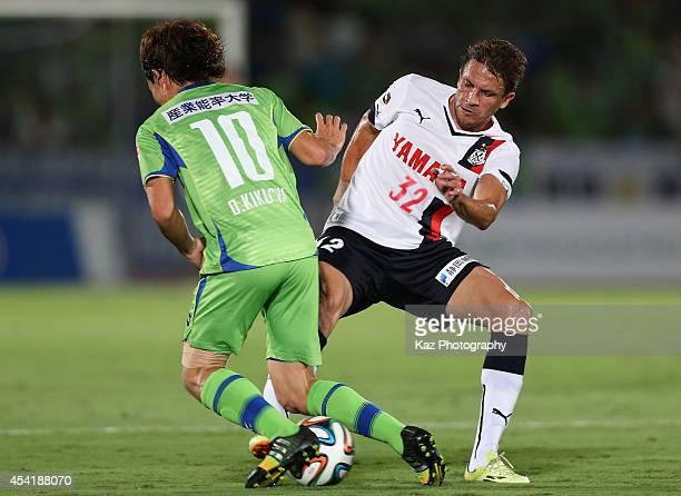 Daisuke Kikuchi of Shonan Bellmare and Ferdinando Pereira Leda of Jubilo Iwata compete for the ball during the J. League second division match...