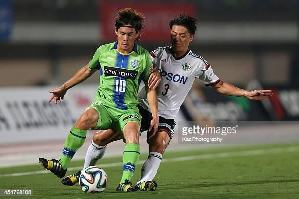 Daisuke Kikuchi of Shonan Bellmare and Hayuma Tanaka of Matsumoto Yamaga compete for the ball during the J.League second division match between...