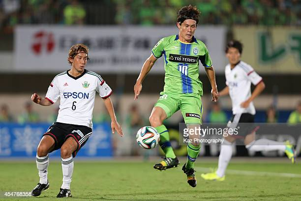 Daisuke Kikuchi of Shonan Bellmare and Shunsuke Iwanuma of Matsumoto Yamaga compete for the ball during the J.League second division match between...