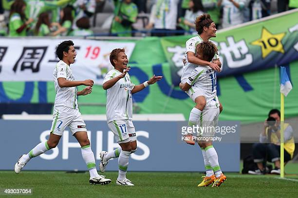 Daisuke Kikuchi of Shonan Bellmare celebrates scoring his team's second goal with his team mates Seiya Fujita Yuto Misao and Shunsuke Kikuchi during...