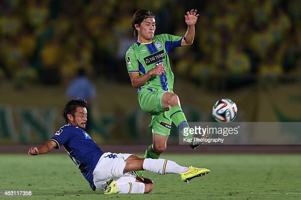 Daisuke Kikuchi of Shonan Bellmare is tackled by Yuto Sato of JEF United Chiba during the J League second division match between Shonan Bellmare and...