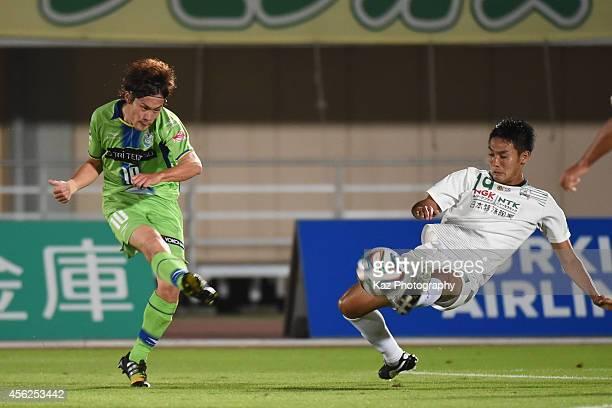 Daisuke Kikuchi of Shonan Bellmare shoots the ball while Tsukasa Masuyama of FC Gifu challenges during the J. League second division match between FC...