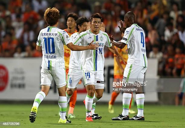 Daisuke Kikuchi, Shuhei Otsuki and Andre Bahia of Shonan Bellmare celebrate their team's first goal scored by Tomoya Inukai of Shimizu S-Pulse during...