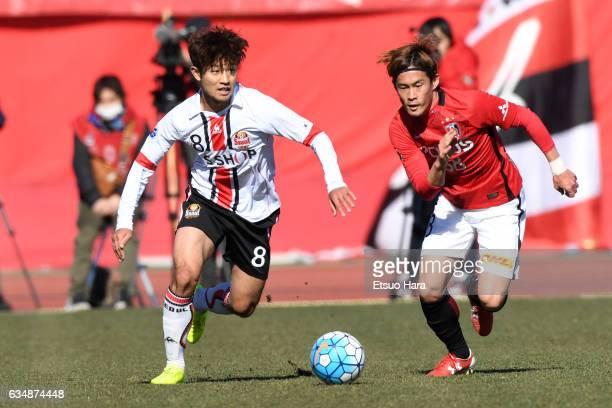 Daisuke Kikuchi#38 of Urawa Red Diamonds and Lee Sang Ho#8 of FC Seoul compete for the ball during the preseason friendly between Urawa Red Diamonds...