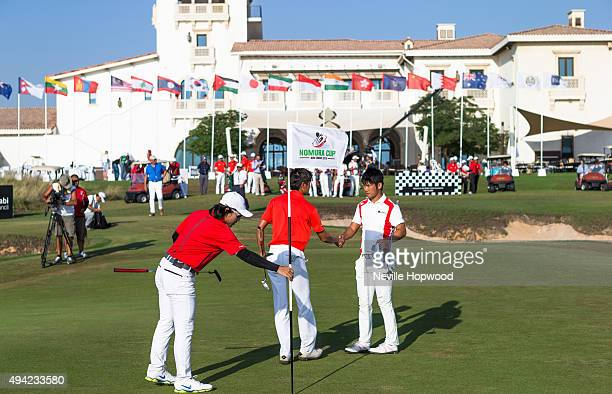 Daisuke Matsubara of Japan shakes hands with James Loew of Singapore, with Han-Ting Chiu of Chinese Taipei during the fourth round of the 27th Nomura...