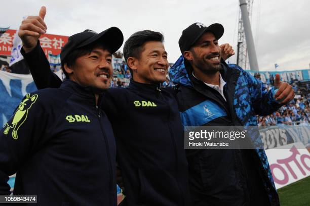 Daisuke Matsui and Kazuyoshi Miura and Ibba of Yokohama FC pose for photograph during the JLeague J2 match between Yokohama FC and Fagiano Okayama at...