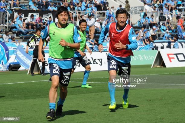Daisuke Matsui of Yokohama FC and Kazuyoshi Miura of Yokohama FC looks on prior to the JLeague J2 match between Yokohama FC and Tokyo Verdy at...