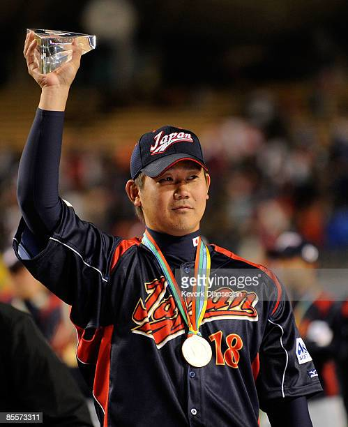 Daisuke Matsuzaka of Japan holds up the the MVP trophy after defeating Korea during the finals of the 2009 World Baseball Classic on March 23 2009 at...