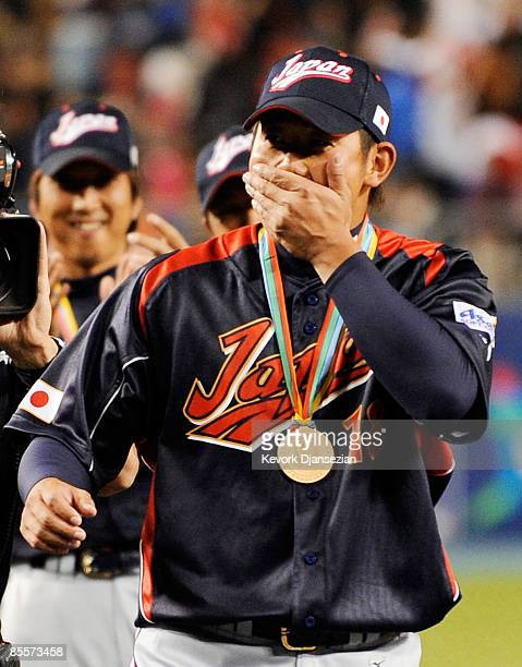 Daisuke Matsuzaka of Japan reacts to being named the MVP trophy after defeating Korea during the finals of the 2009 World Baseball Classic on March...