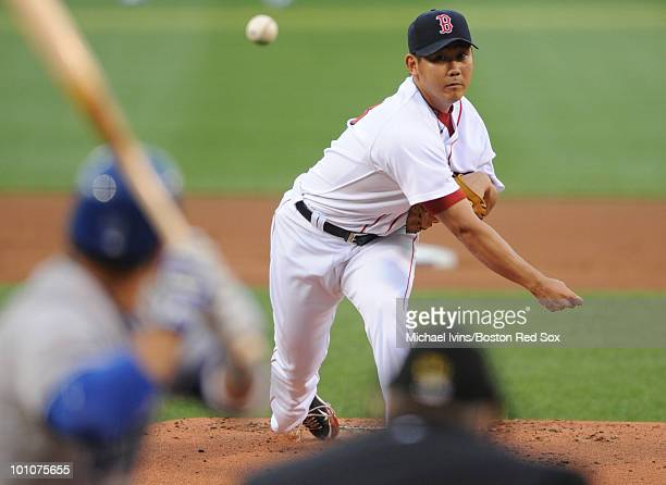 Daisuke Matsuzaka of the Boston Red Sox pitches against the Kansas City Royals in the first inning on May 27 2010 at Fenway Park in Boston...