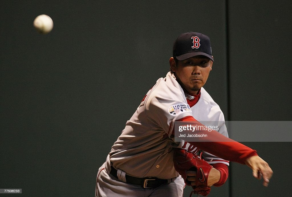 Daisuke Matsuzaka #18 of the Boston Red Sox throws a warm-up pitch in the bullpen prior to Game Three of the 2007 Major League Baseball World Series against the Colorado Rockies at Coors Field on October 27, 2007 in Denver, Colorado.
