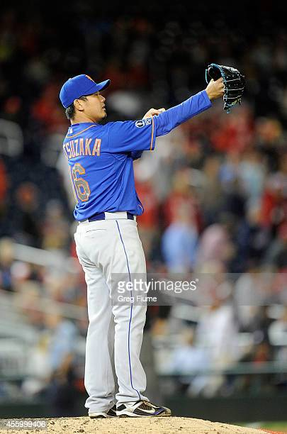 Daisuke Matsuzaka of the New York Mets adjusts his shirt during the eighth inning against the Washington Nationals at Nationals Park on September 23...