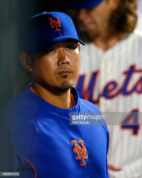 Daisuke Matsuzaka of the New York Mets looks on from the dugout during a game against the Milwaukee Brewers on June 12 2014 at Citi Field in the...