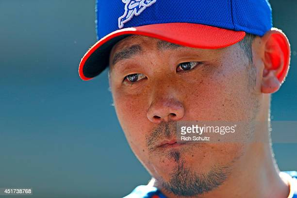 Daisuke Matsuzaka of the New York Mets observes the field during pregame warmups before the start of their game against the Texas Rangers on July 5...