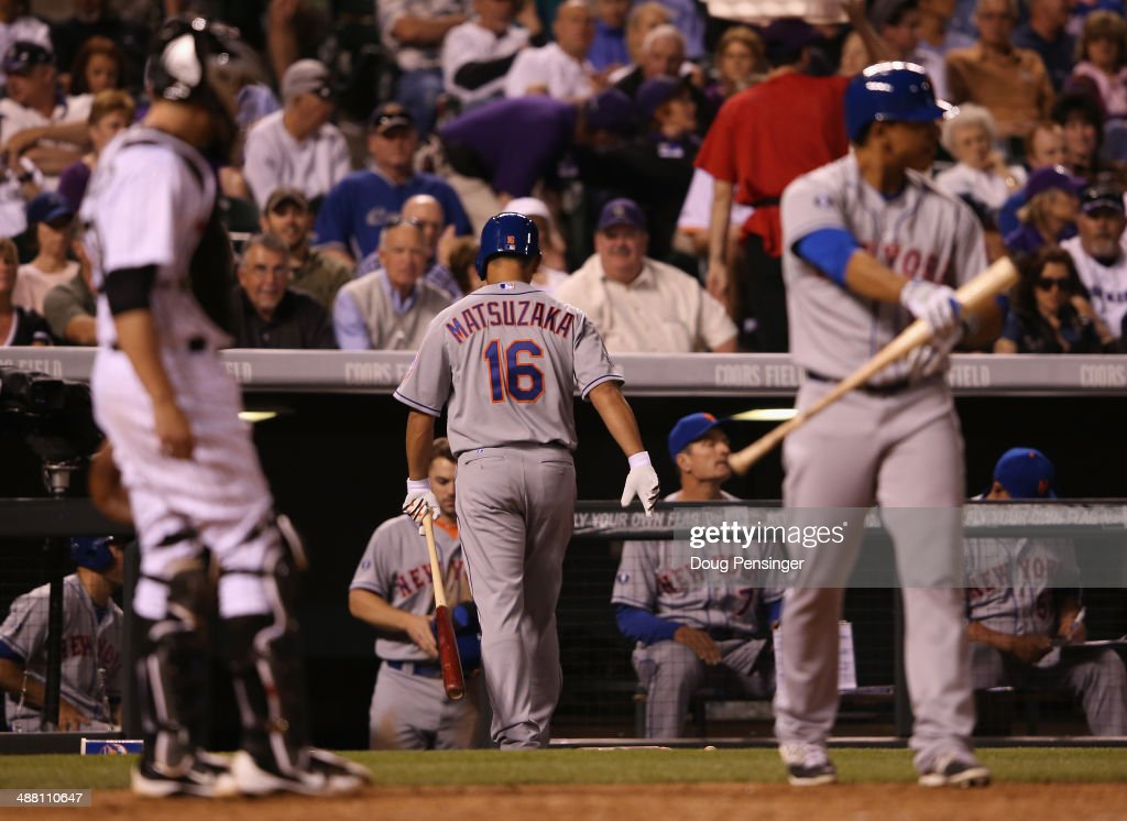 Daisuke Matsuzaka #16 of the New York Mets returns to the dugout after striking out bunting against relief pitcher Rex Brothers #49 of the Colorado Rockies in the seventh inning at Coors Field on May 3, 2014 in Denver, Colorado. The Rockies defeated the Mets 11-10.