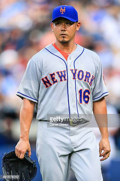Daisuke Matsuzaka of the New York Mets walks to the dugout after the first inning against the Atlanta Braves at Turner Field on July 1 2014 in...