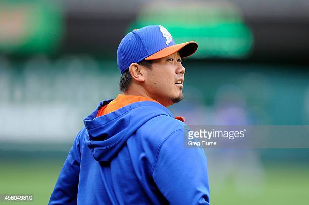 Daisuke Matsuzaka of the New York Mets walks to the outfield before the game against the Washington Nationals at Nationals Park on September 24 2014...