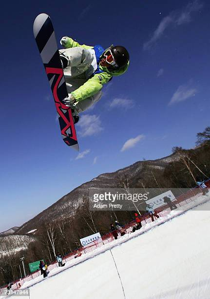 Daisuke Murakami of Japan gets some big air during the men's snowboard half pipe final of the sixth Asian Winter Games at Jilin Beida Lake Skiing...