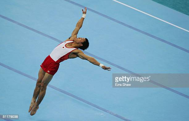 Daisuke Nakano of Japan competes in the floor exercise of the men's artistic gymnastics team final competition on August 16 2004 during the Athens...