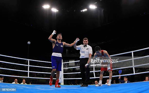 Daisuke Narimatsu of Japan bows his head after losing a fight against Carlos Zenon Balderas Jr of the United States in their Mens Lightweight 60kg...