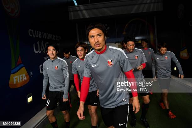 Daisuke Nasu leads his team out to warm up prior to the FIFA Club World Cup UAE 2017 fifth place playoff match between Wydad Casablanca and Urawa...