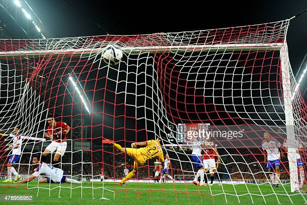 Daisuke Nasu of Urawa Reds scores his team's fifth goal past goalkeeper Tatsuya Morita of Albirex Niigata during the J.League match between Urawa Red...