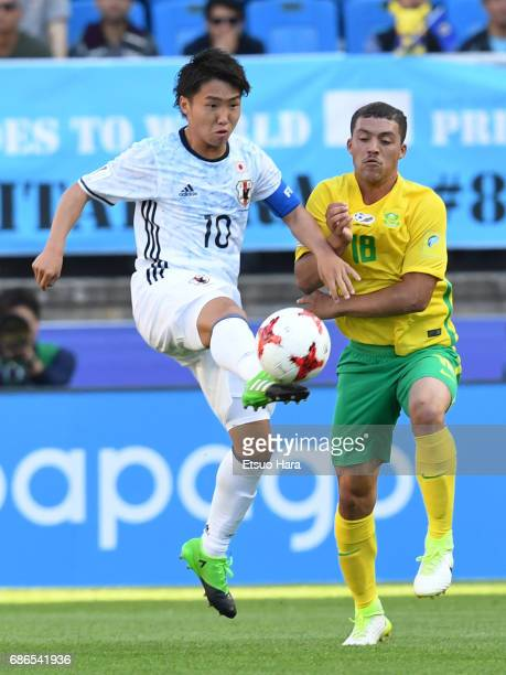 Daisuke Sakai of Japan and Grand Margeman of South Africa compete for the ball during the FIFA U20 World Cup Korea Republic 2017 group D match...