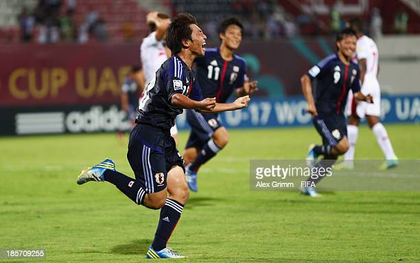 Daisuke Sakai of Japan celebrates his team's first goal during the FIFA U17 World Cup UAE 2013 Group D match between Japan and Tunisia at Sharjah...