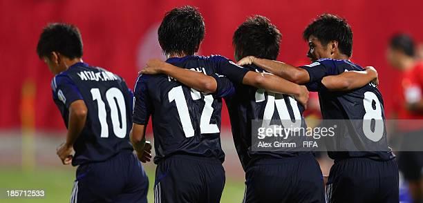 Daisuke Sakai of Japan celebrates his team's first goal with team mates Takuma Mizutani Koji Miyoshi and Taro Sugimoto during the FIFA U17 World Cup...