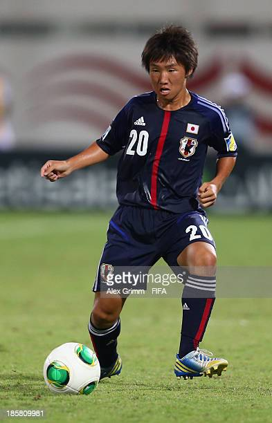 Daisuke Sakai of Japan controles the ball during the FIFA U17 World Cup UAE 2013 Group D match between Japan and Tunisia at Sharjah Stadium on...