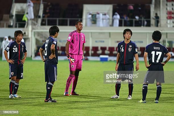 Daisuke Sakai Rikiya Motegi Teimosii Shiraoka Shota Saito and Kosei Uryu of Japan react after the FIFA U17 World Cup UAE 2013 Round of 16 match...
