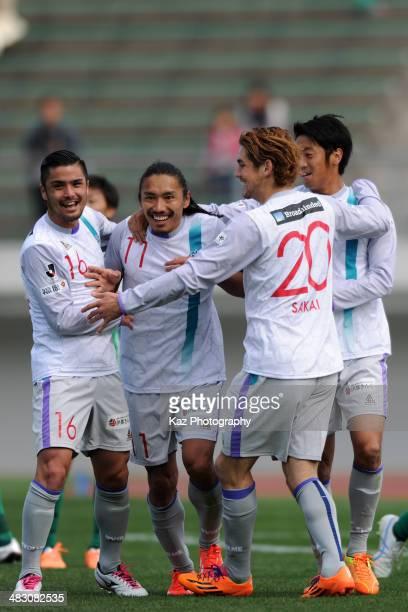 Daisuke Sakata of Avispa Fukuoka celebrates scoring his team's first goal with his teammates during the JLeague second division match between FC Gifu...