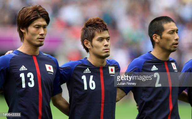 Daisuke Suzuki of Japan, Hotaru Yamaguchi of Japan and Yuhei Tokunaga of Japan look on during the Men's Football Semi Final match between Mexico and...