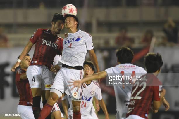 Daisuke Suzuki of Urawa Red Diamonds and Takato Nonomura of Ryutsu Keizai University compete for the ball during the 99th Emperor's Cup 2nd Round...