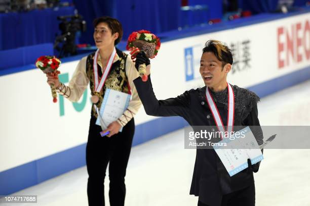 Daisuke Takahashi and Keiji Tanaka smile with their medals after the men's free skating on day four of the 87th Japan Figure Skating Championships at...