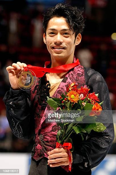 Daisuke Takahashi of Japan poses for photographers after winning the men's program during Skate America at Rose Garden Arena on November 13 2010 in...